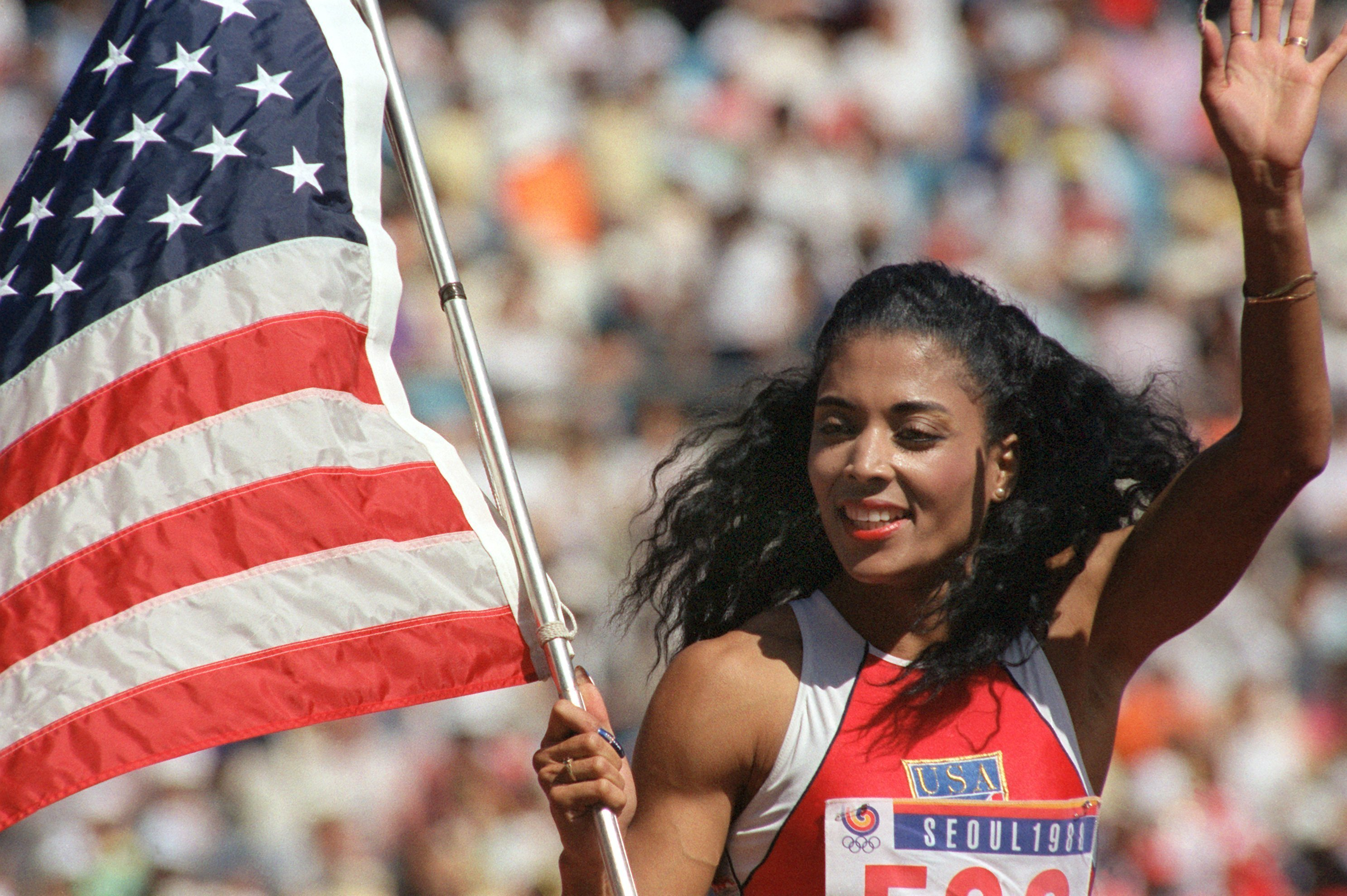 Florence Griffith-Joyner came home from the 1988 Olympics with three gold medals and one silver. | dpa/picture alliance via Getty Images