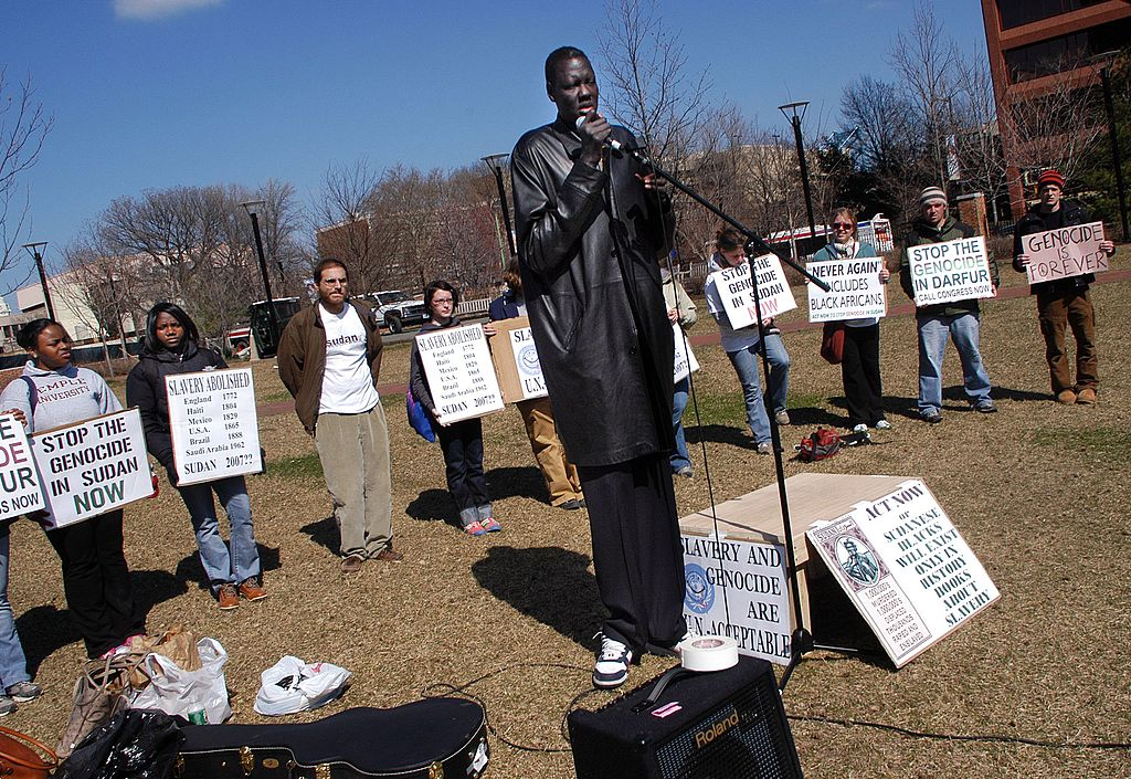 Former NBA star, Manute Bol, speaks as he and other Sudanese natives participate in a 2006 rally for action to end the violence in Sudan