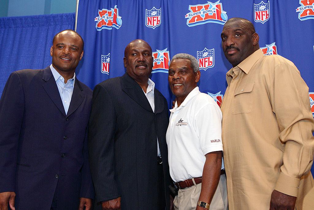 Former NFL quarterbacks (L-R) Warren Moon, James Harris, Marlin Briscoe and Doug Williams