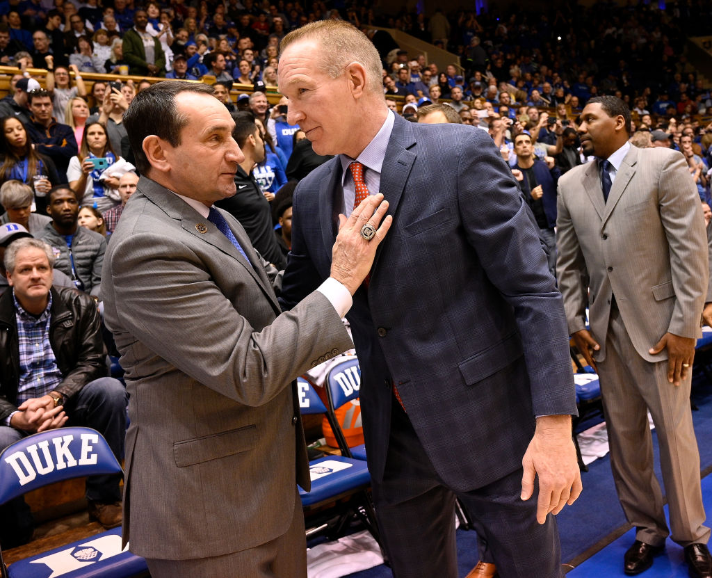 Head coach Mike Krzyzewski of the Duke Blue Devils and head coach Chris Mullin of the St. John's Red Storm greet each other