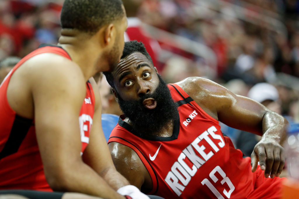 James Harden of the Houston Rockets reacts on the bench