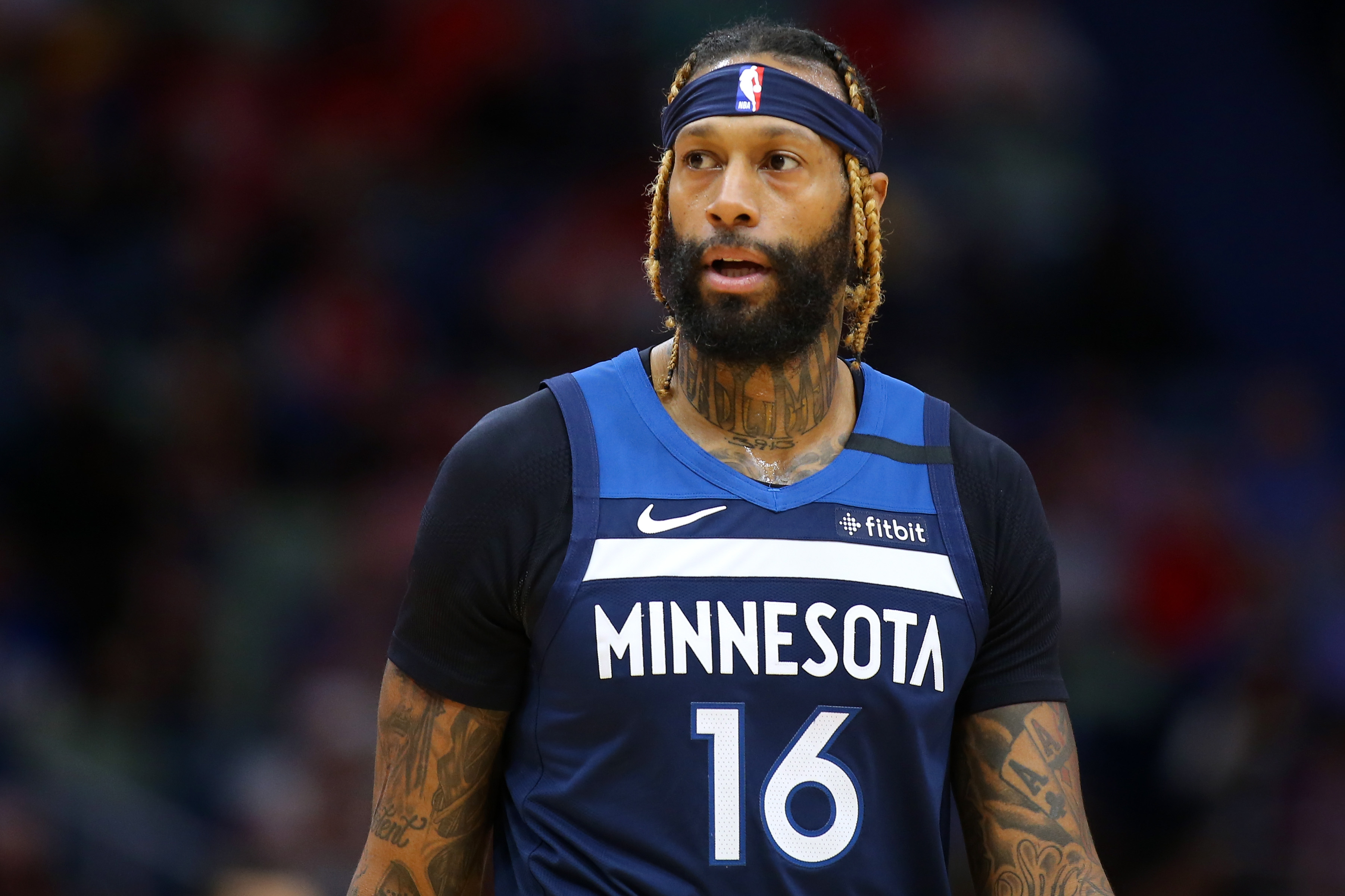 James Johnson looks on during a Timberwolves game