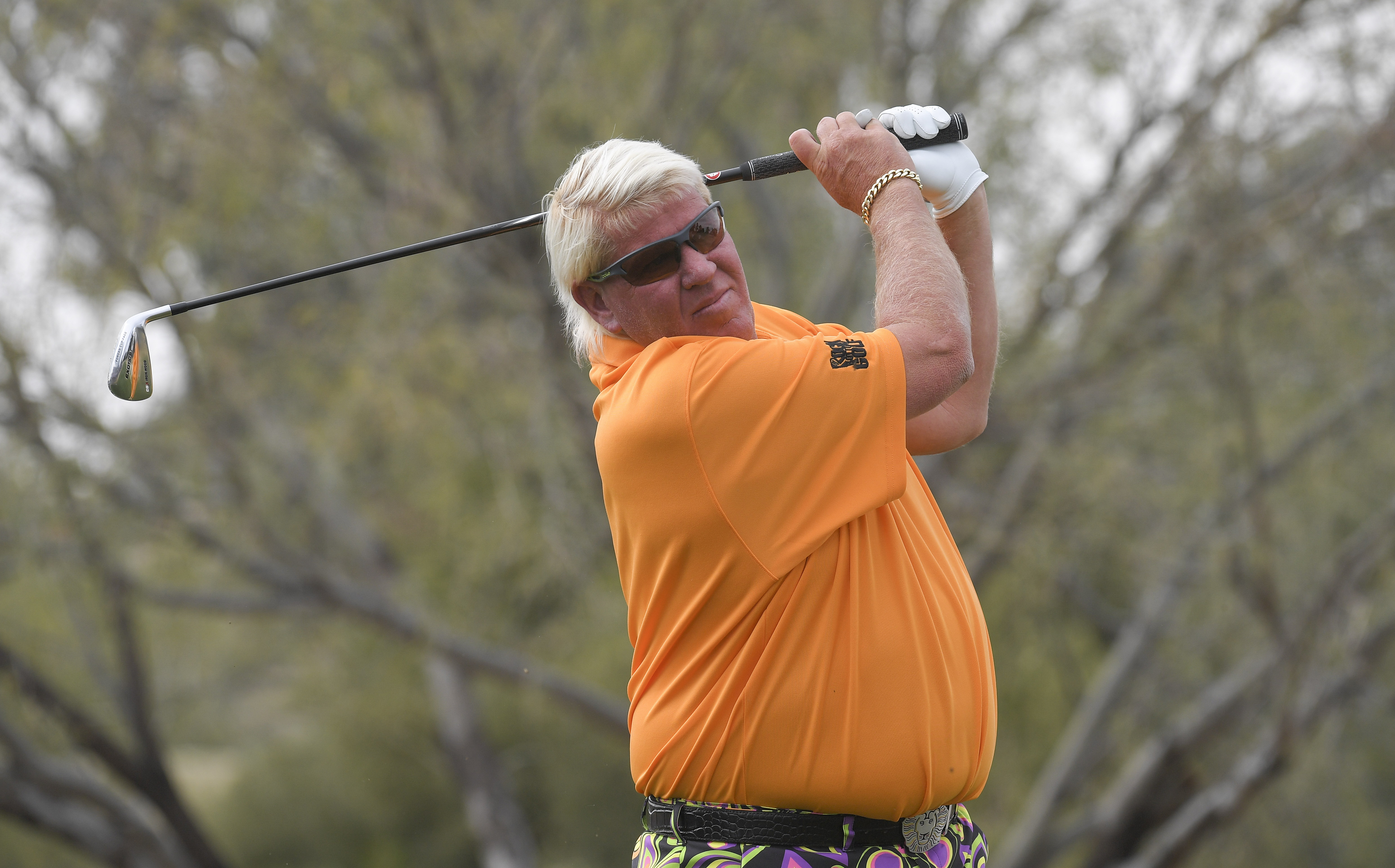 John Daly hits a tee shot
