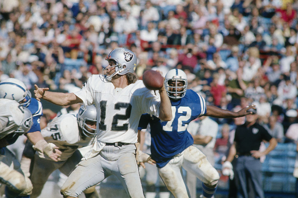 Ken Stabler cocking back to throw a pass during a Raiders game