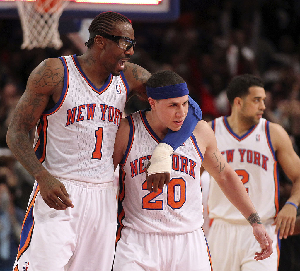 The Knicks' Amare' Stoudemire grabs Mike Bibby