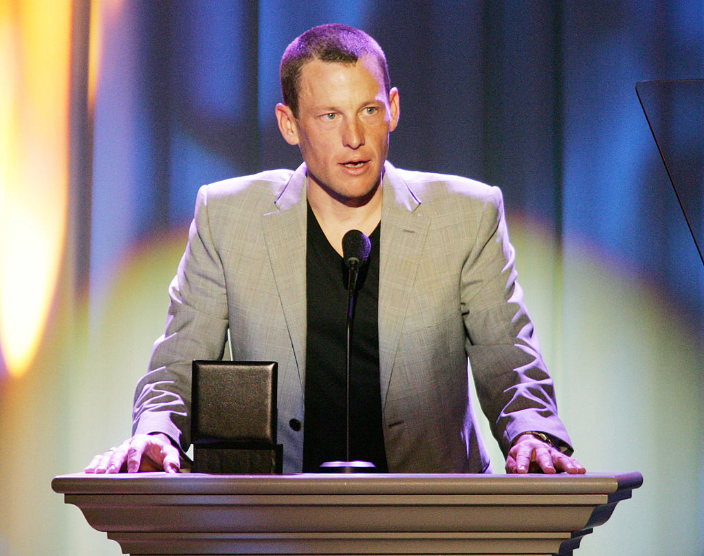 Lance Armstrong standing at a podium after winning an award