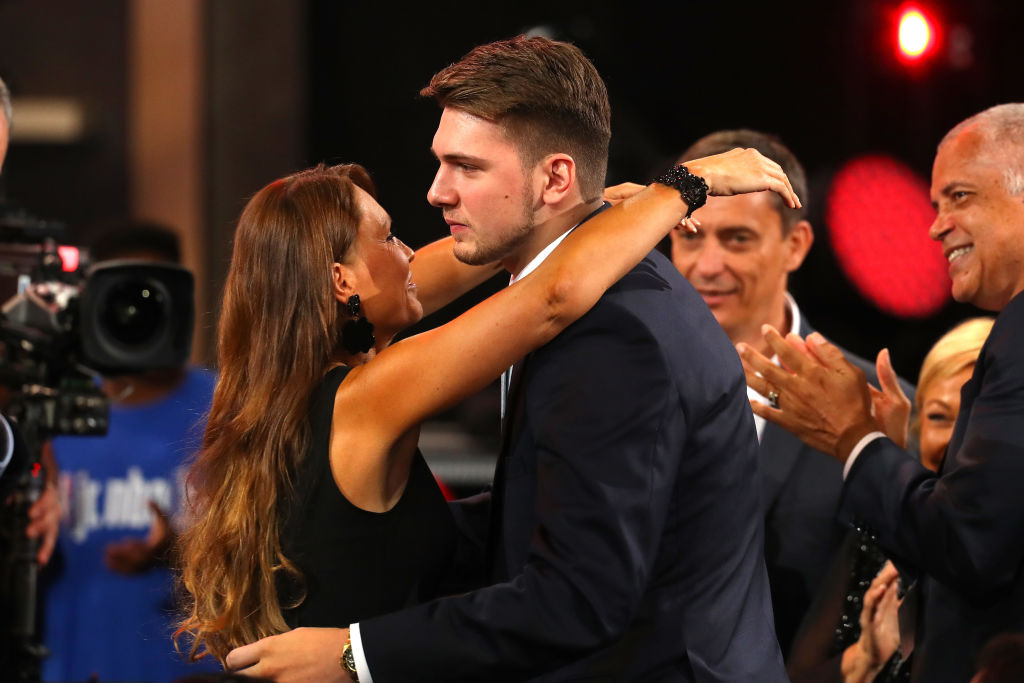 Luka Doncic reacts after being drafted third overall