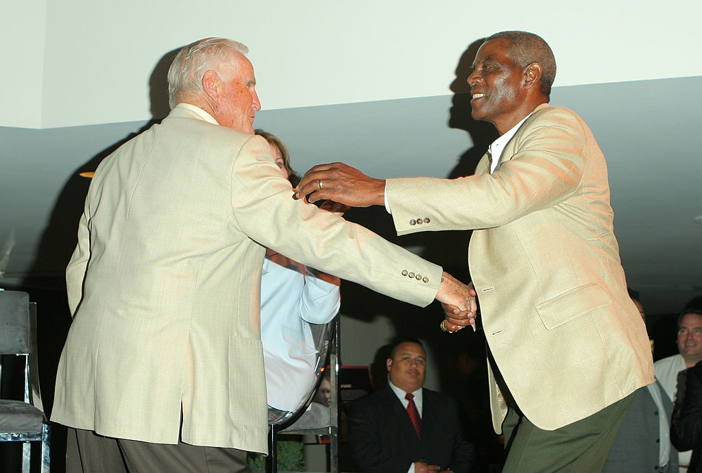 Don Shula and Marlin Briscoe greeting each other