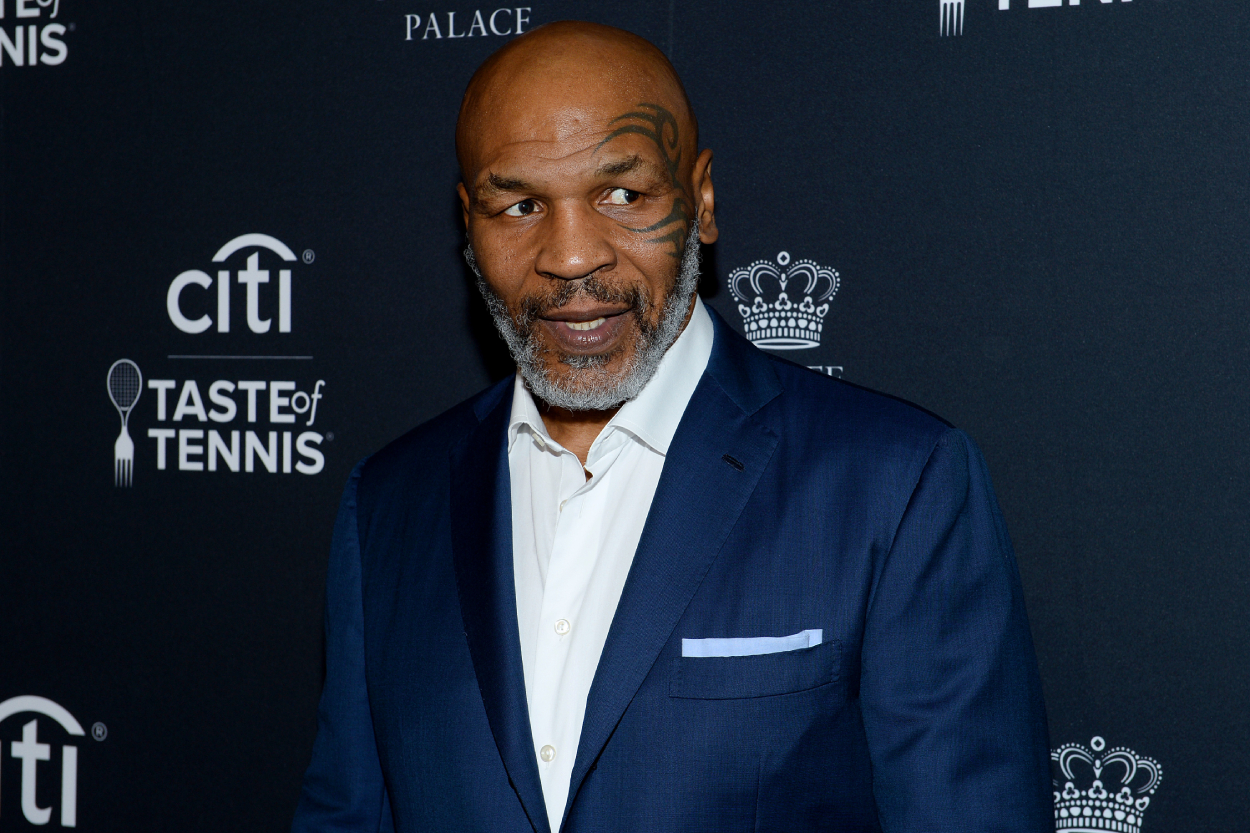 Mike Tyson wearing a blue suit at a charity event