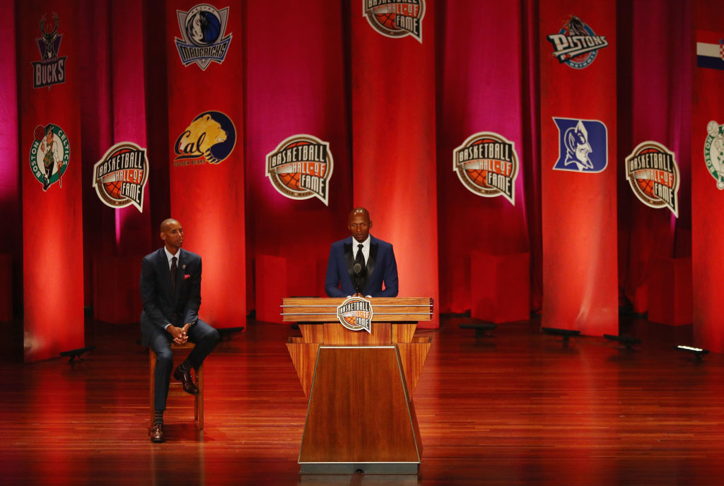 Enshrinee Ray Allen speaks as Reggie Miller looks on during the 2018 Basketball Hall of Fame Enshrinement Ceremony