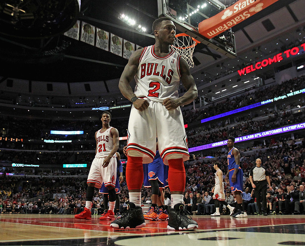 Nate Robinson flexing after scoring a basket in an NBA game