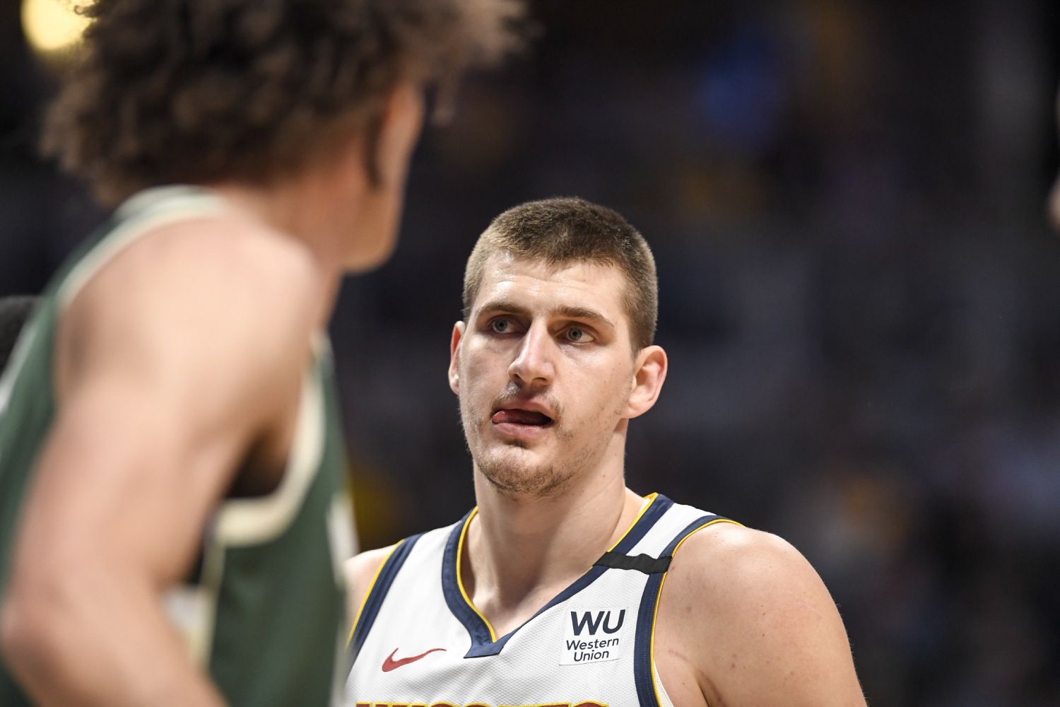 Nikola Jokic looking on during a Nuggets game