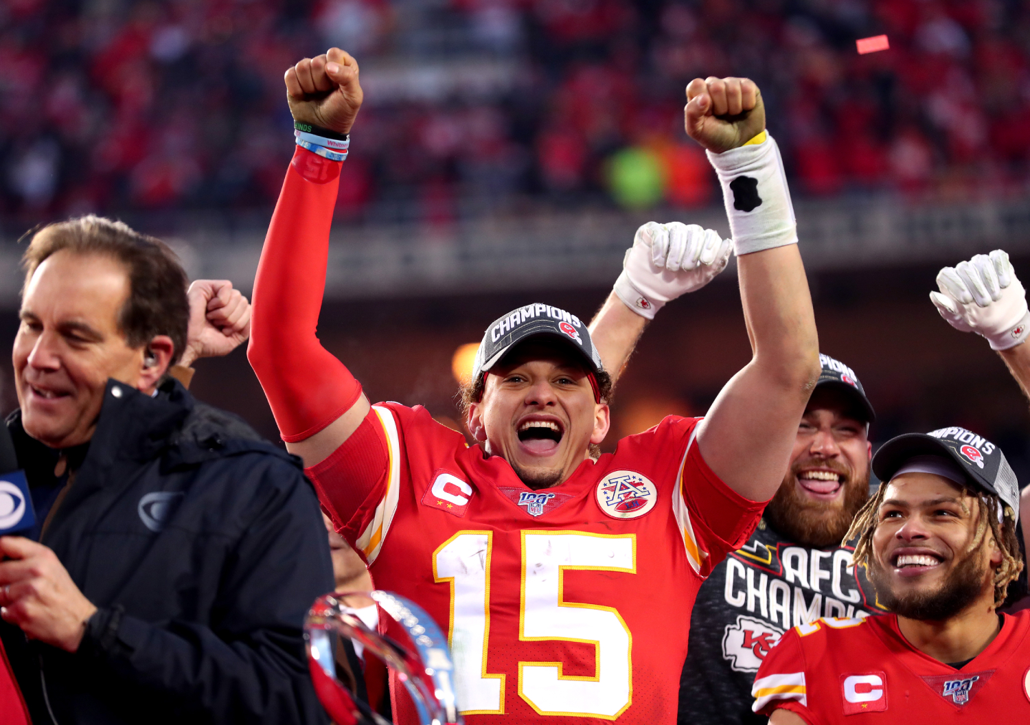 Patrick Mahomes celebrating with his teammates after winning the Super Bowl