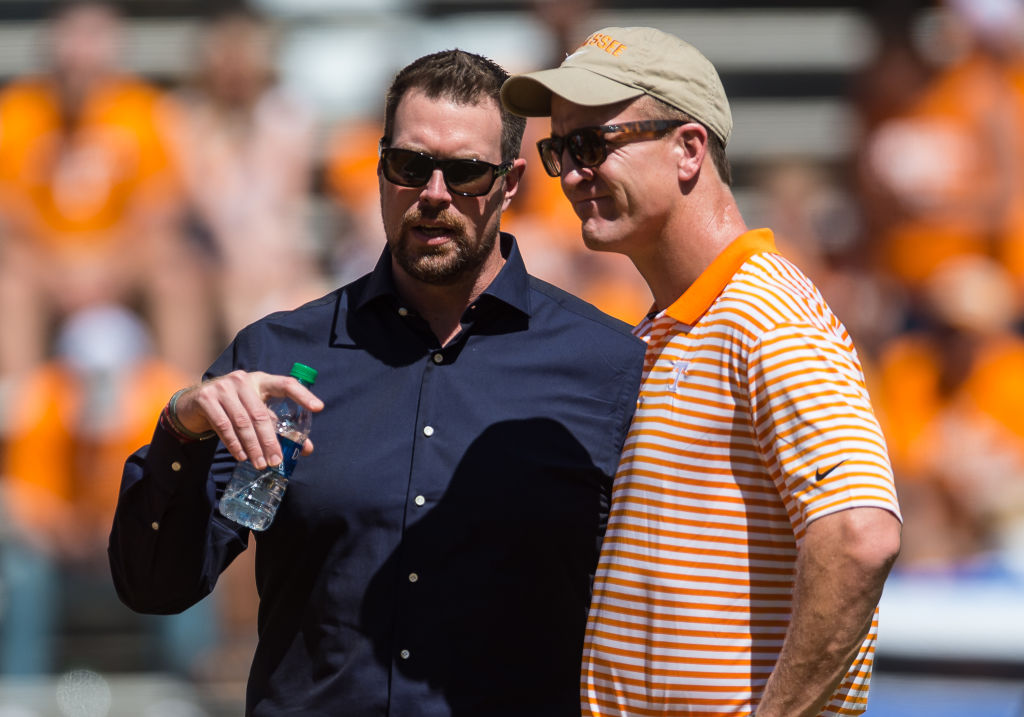 Peyton Manning and Ryan Leaf talk before a college football game in 2019