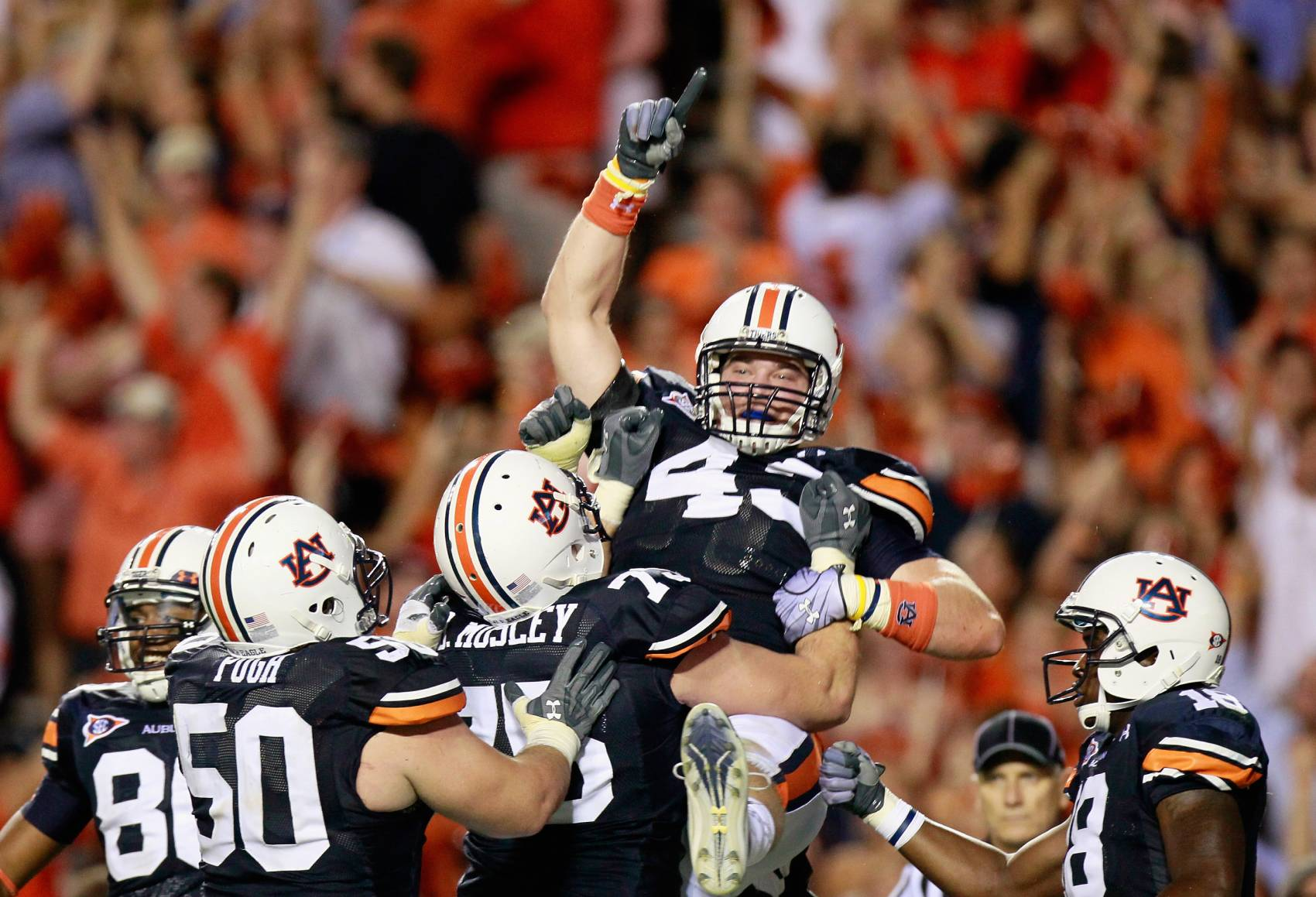 Former Auburn tight end Philip Lutzenkirchen (middle) died tragically in 2014.