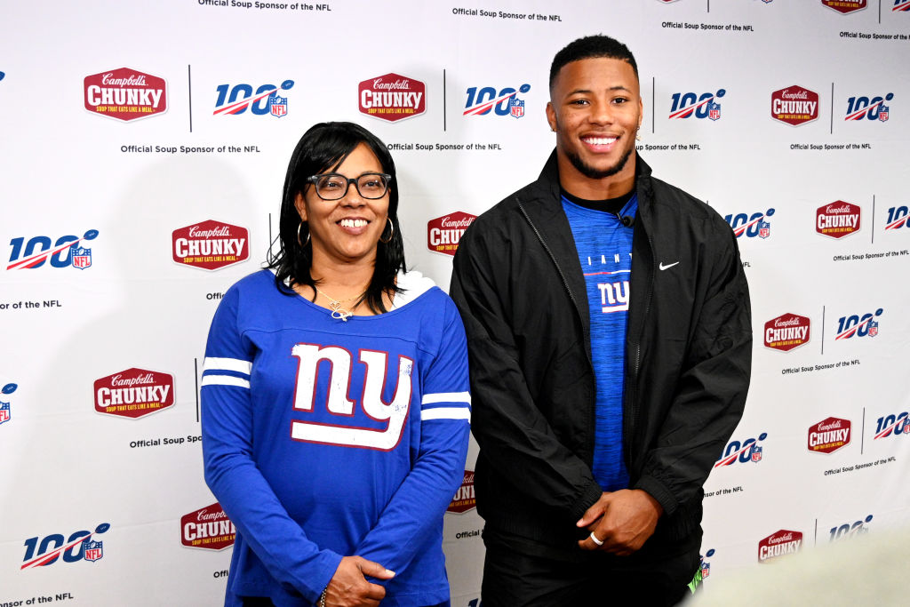 Saquon Barkley takes a photo at a charity event