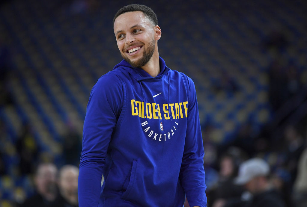 Stephen Curry of the Golden State Warriors laughs