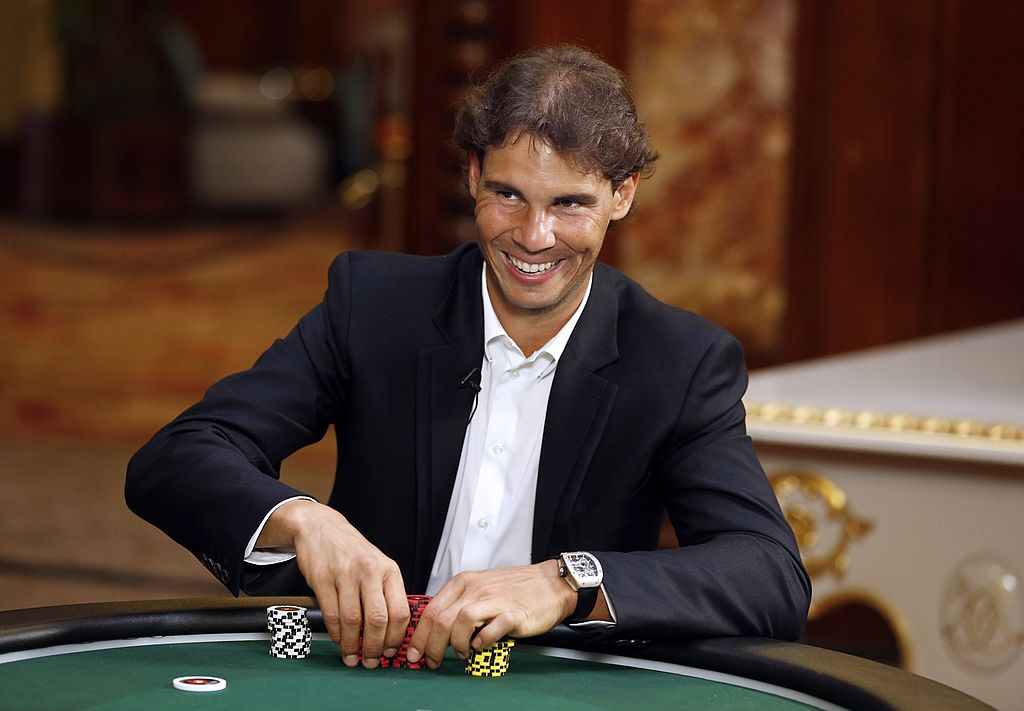 Spain's tennis champion Rafael Nadal smiles as he plays a poker match