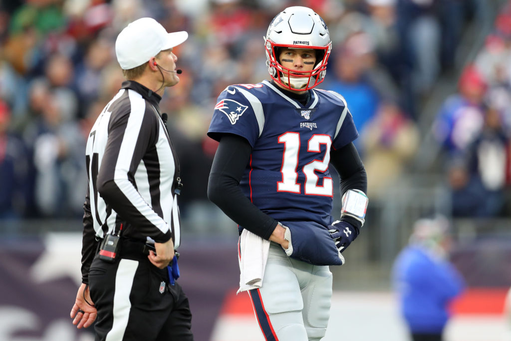 Tom Brady talking with a referee during an NFL game