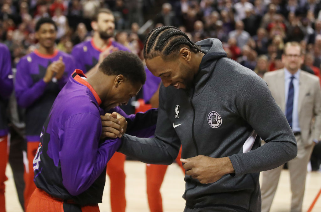 Raptors guard Kyle Lowry awards LA Clippers forward Kawhi Leonard his NBA championship ring