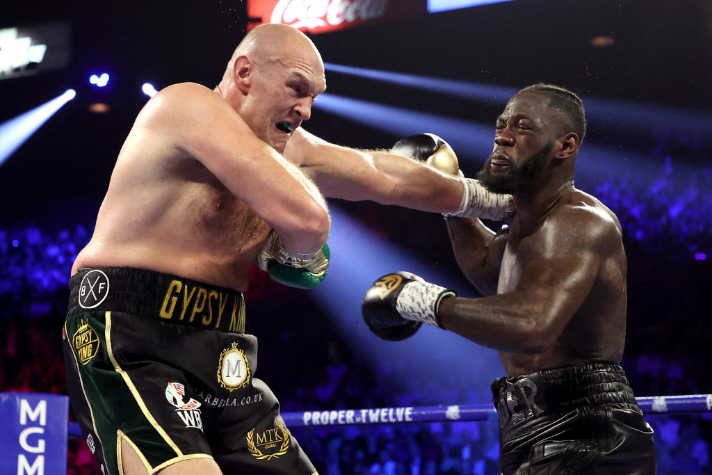 Tyson Fury and Deontay Wilder exchange punches