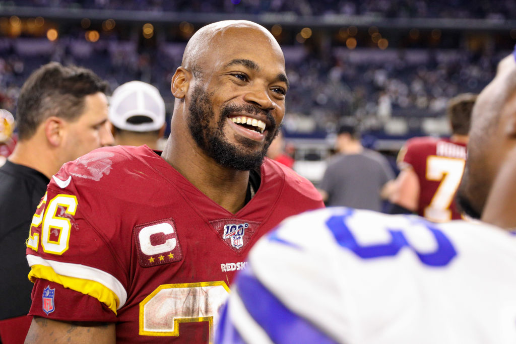 Washington Redskins running back Adrian Peterson talks with players