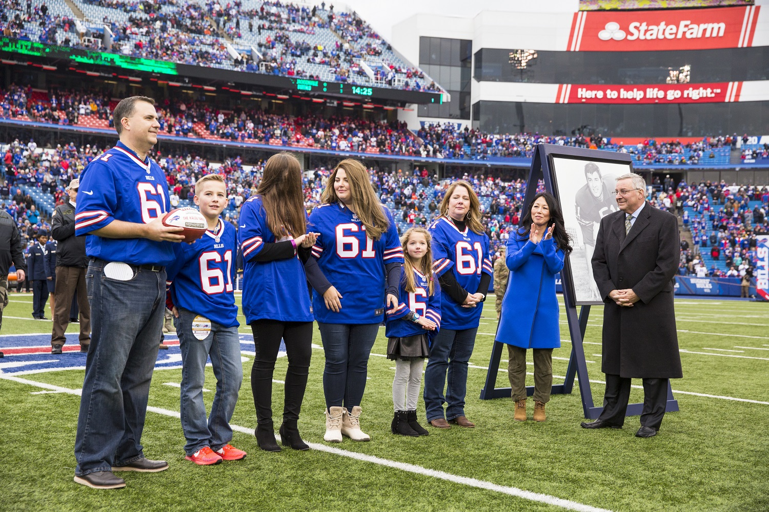 Buffalo Bills owners Kim and Terry Pegula, right, honor the family of Bob Kalsu during a ceremony at New Era Field on Nov. 27, 2016. | Brett Carlsen/Getty Images