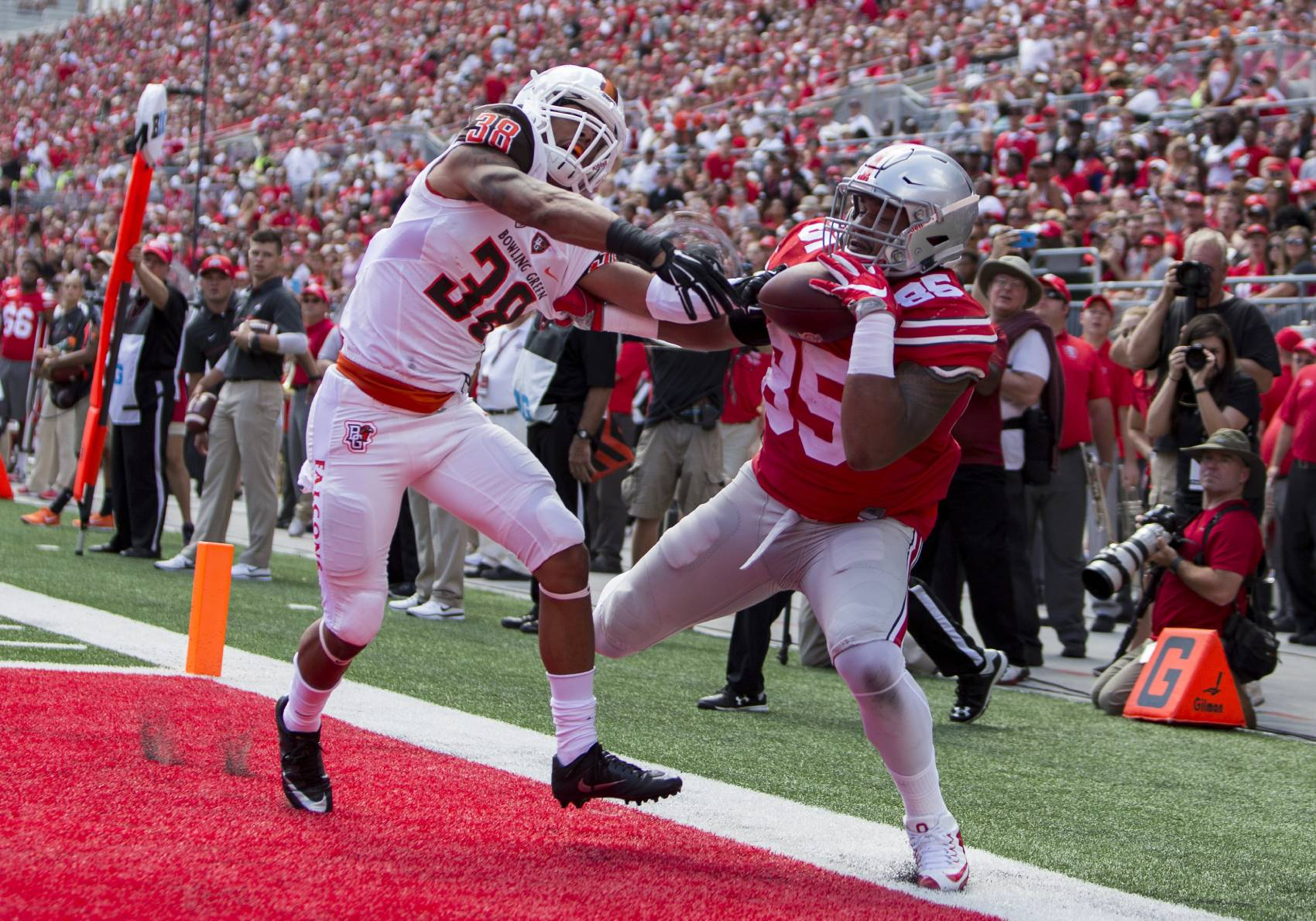 Bowling Green's football program (white) will incur a significant financial loss from not playing Ohio State this season.