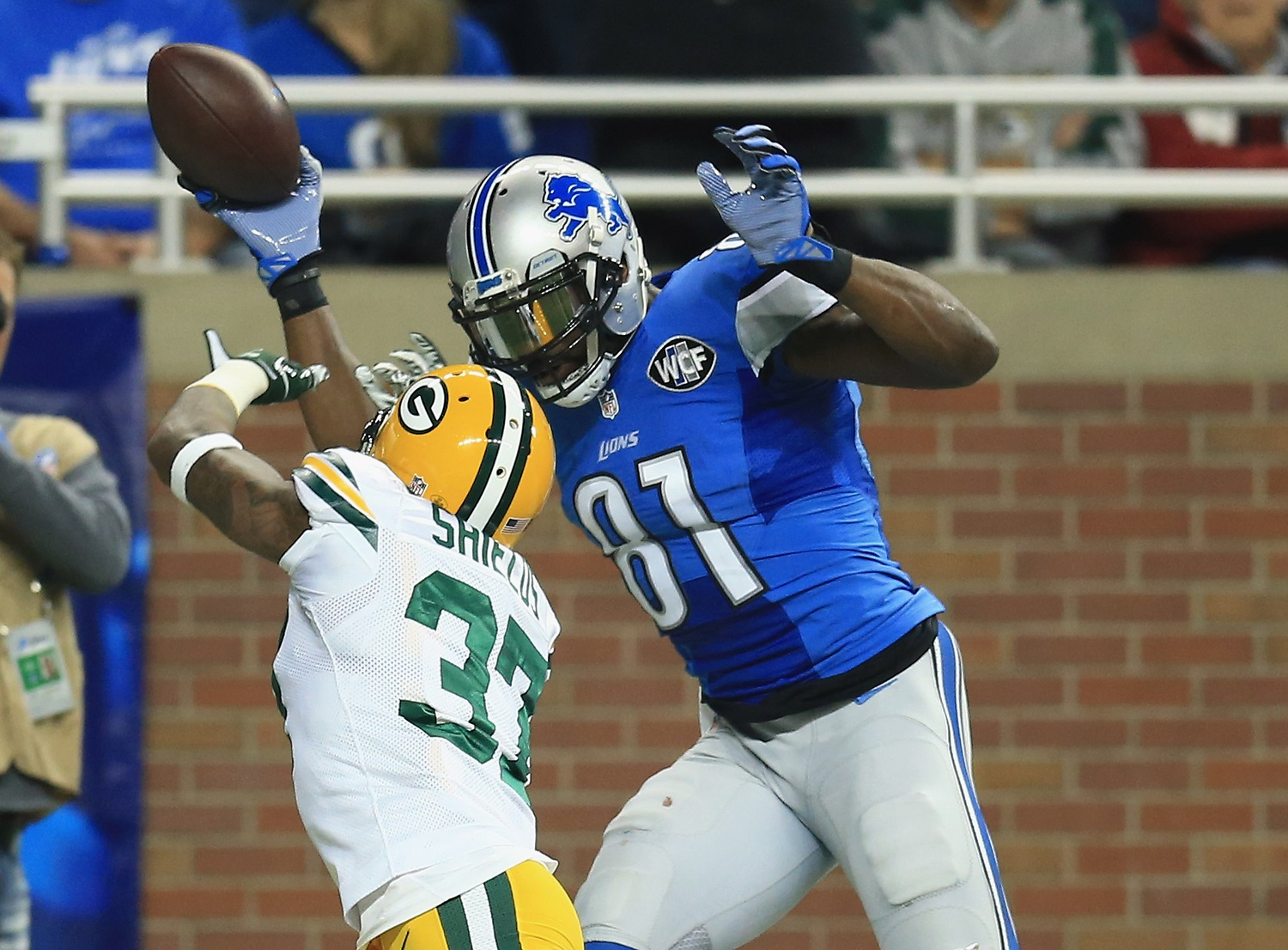 Receiver Calvin Johnson holds the NFL record for receiving yards in a season. | Andrew Weber/Getty Images