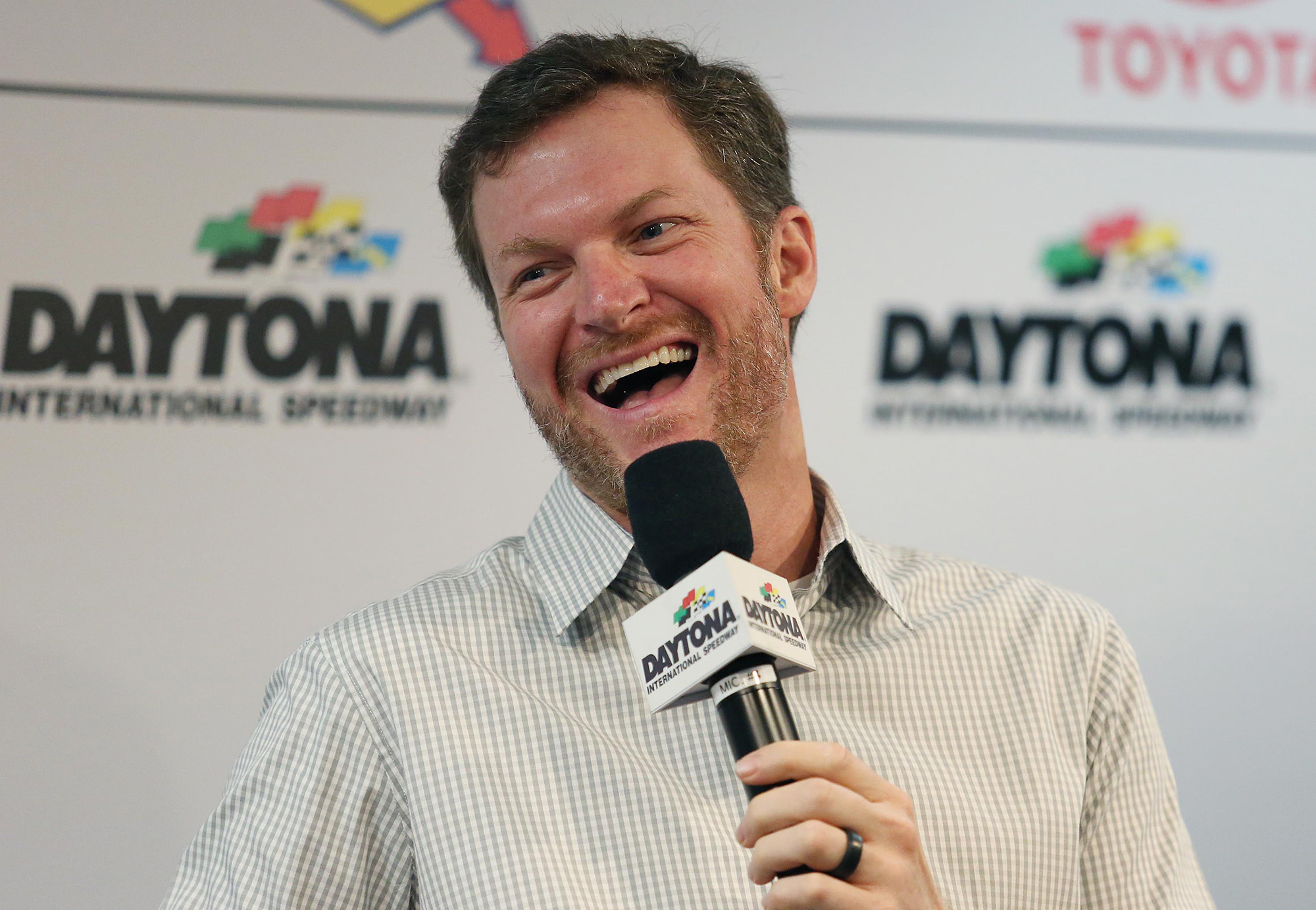 Dale Earnhardt Jr. laughs in a press conference