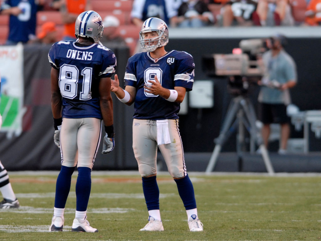 Quarterback Tony Romo of the Dallas Cowboys talks with wide receiver Terrell Owens