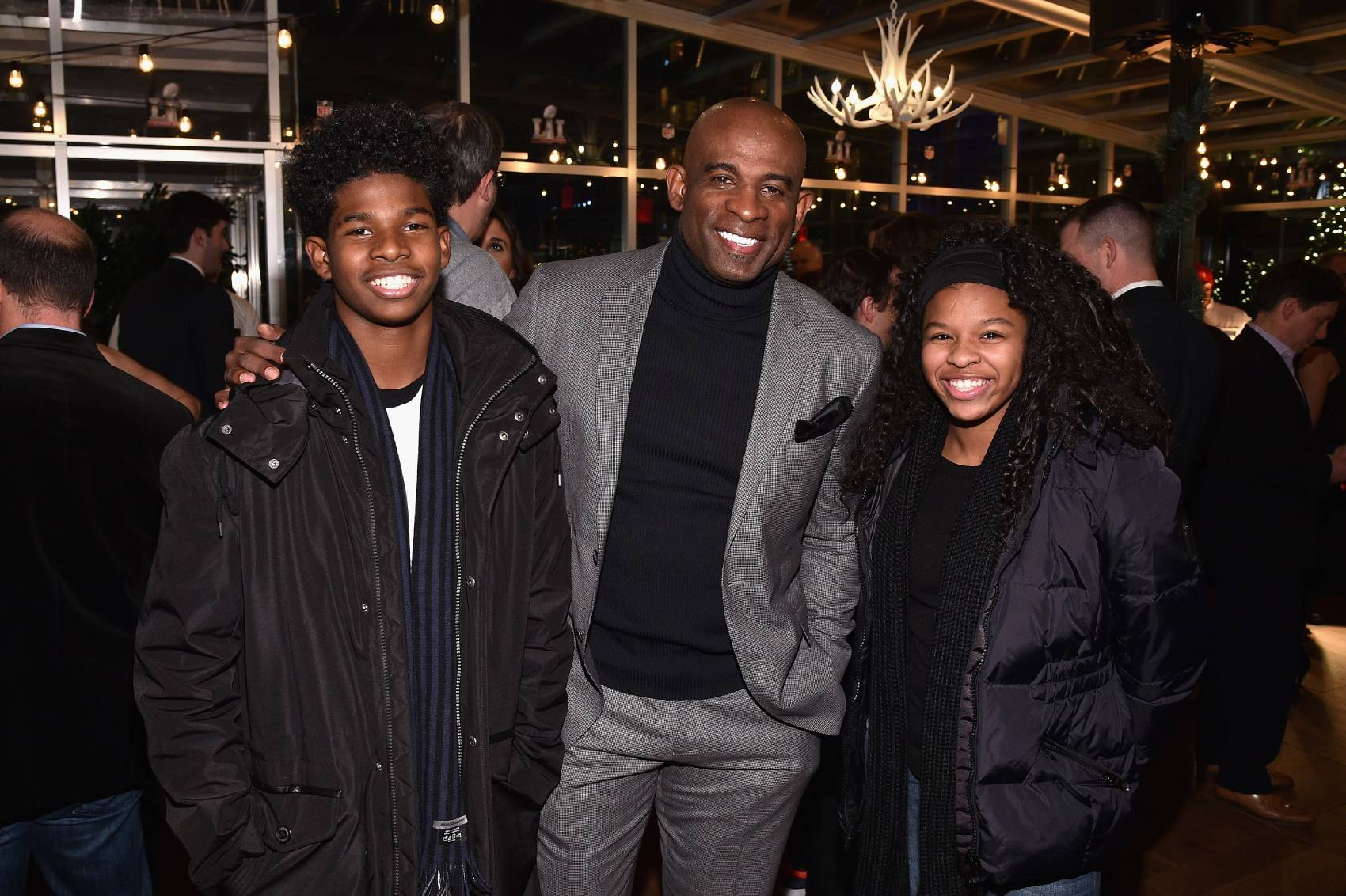 Shedeur Sanders (left) is the son of Pro Football Hall of Fame cornerback Deion Sanders. A high school quarterback, Shedeur committed to Florida Atlantic University on July 13.