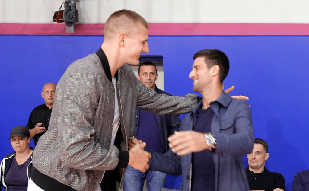 Denver Nuggets basketball player Nikola Jokic (L) of Serbia and Novak Djokovic of Serbia