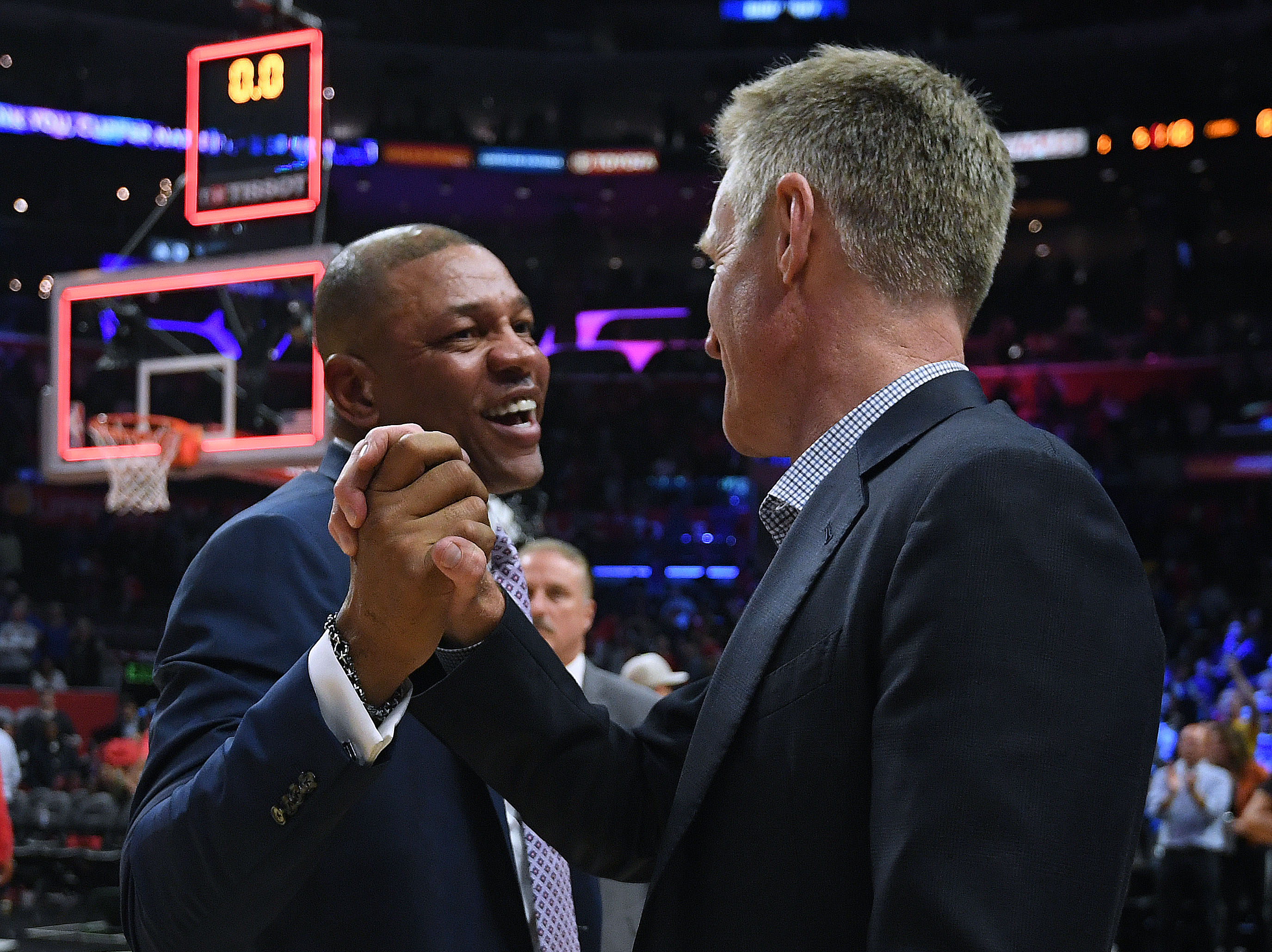 Doc Rivers of the LA Clippers and Steve Kerr of the Golden State Warriors shake hands