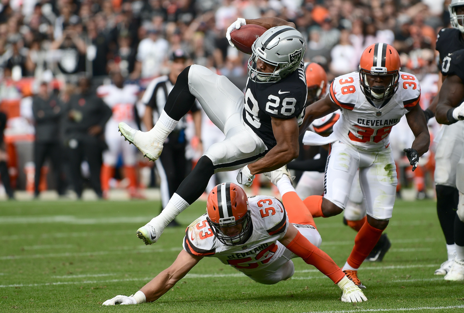 Doug Martin of the Oakland Raiders gets tackled by Joe Schobert of the Cleveland Browns in 2018