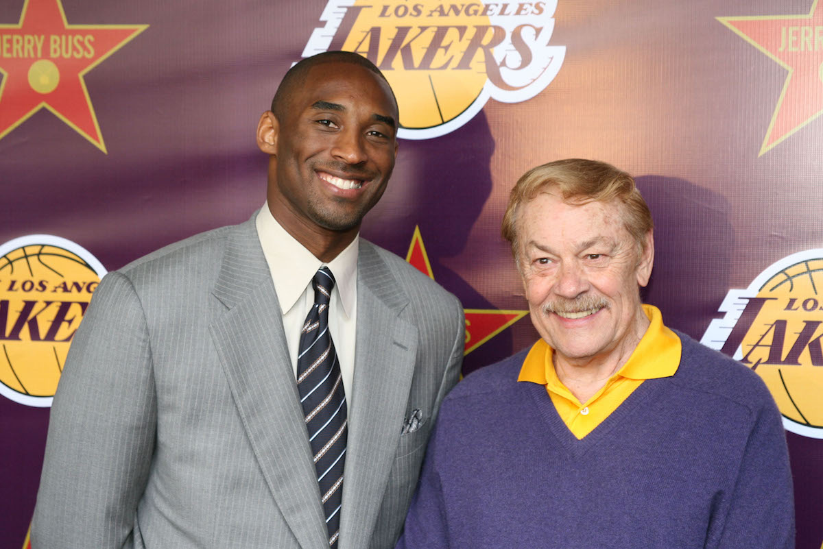 Jerry Buss standing next to Kobe Bryant