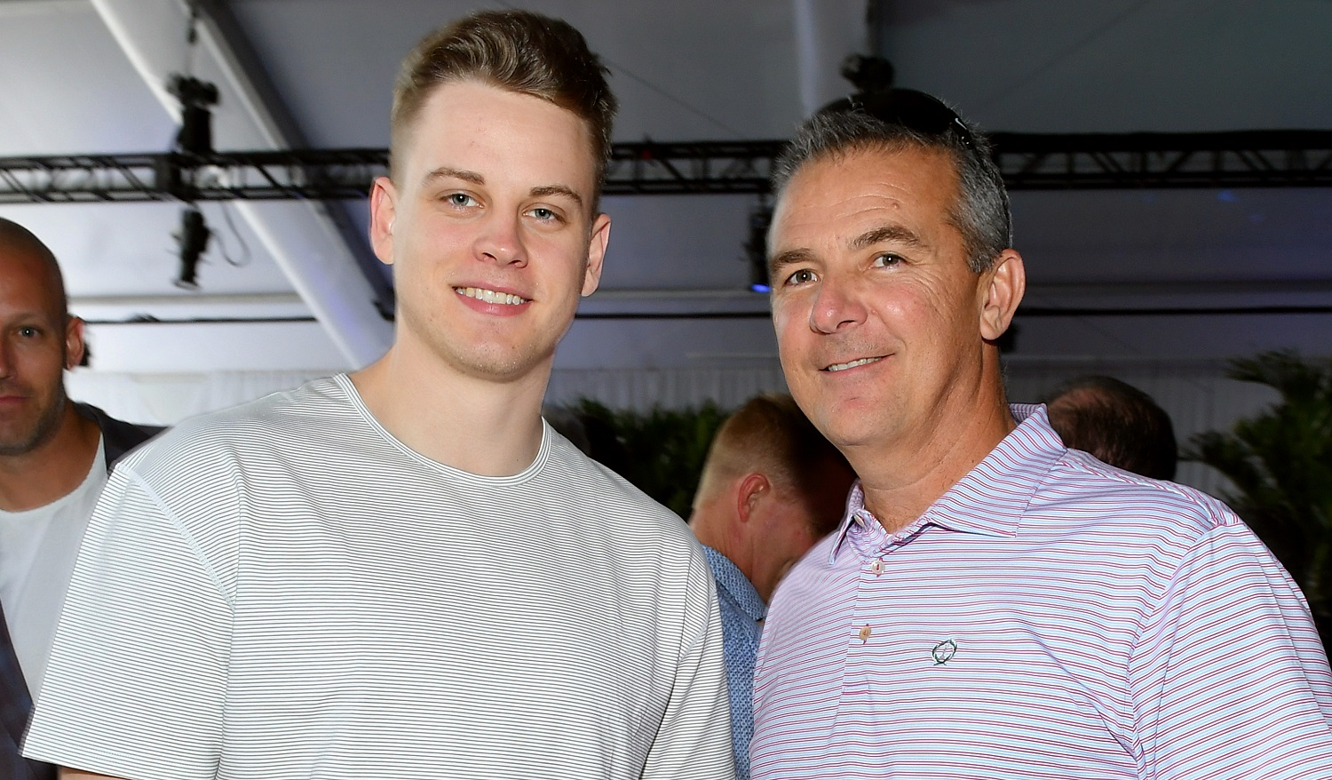 Joe Burrow, left, spent three seasons in Urban Meyer's Ohio State program before transferring to LSU. | Mike Coppola/Getty Images for Fanatics)