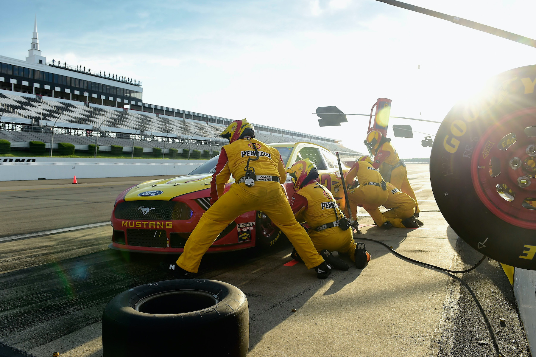 Joey Logano, driver of the #22 Shell Pennzoil Ford, and his pit crew