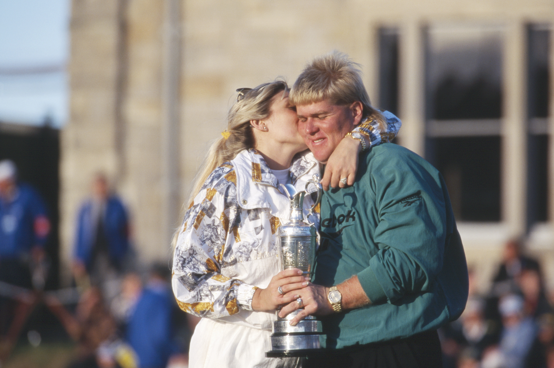 John Daly gets a kiss from his wife Paulette following his victory during the 1995 124th Open Championship