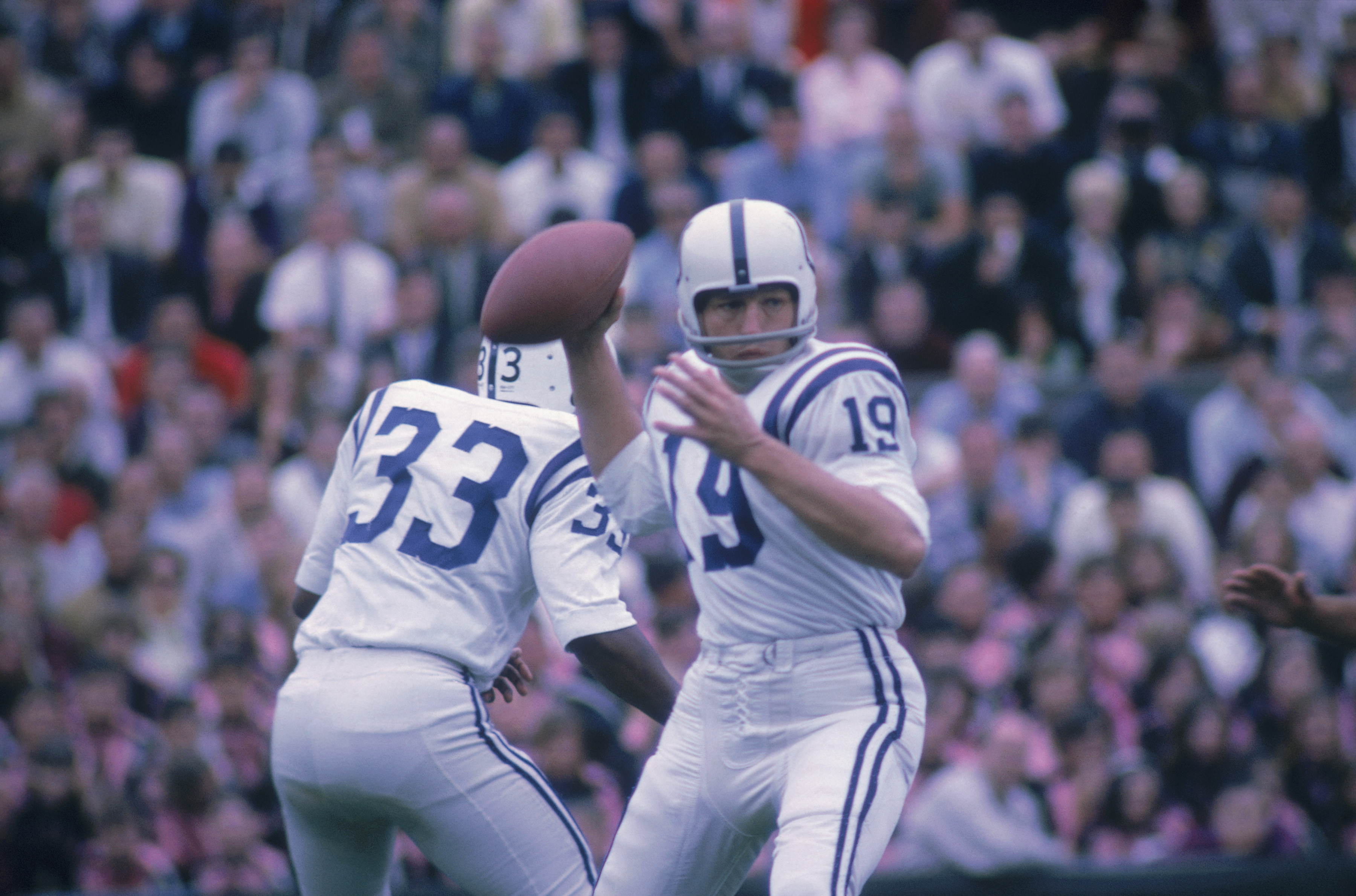 Johnny Unitas throwing a pass