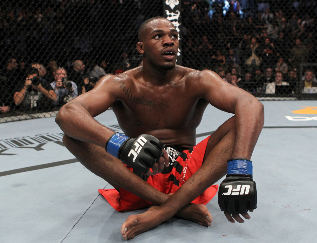Jon Jones sitting on the UFC mat