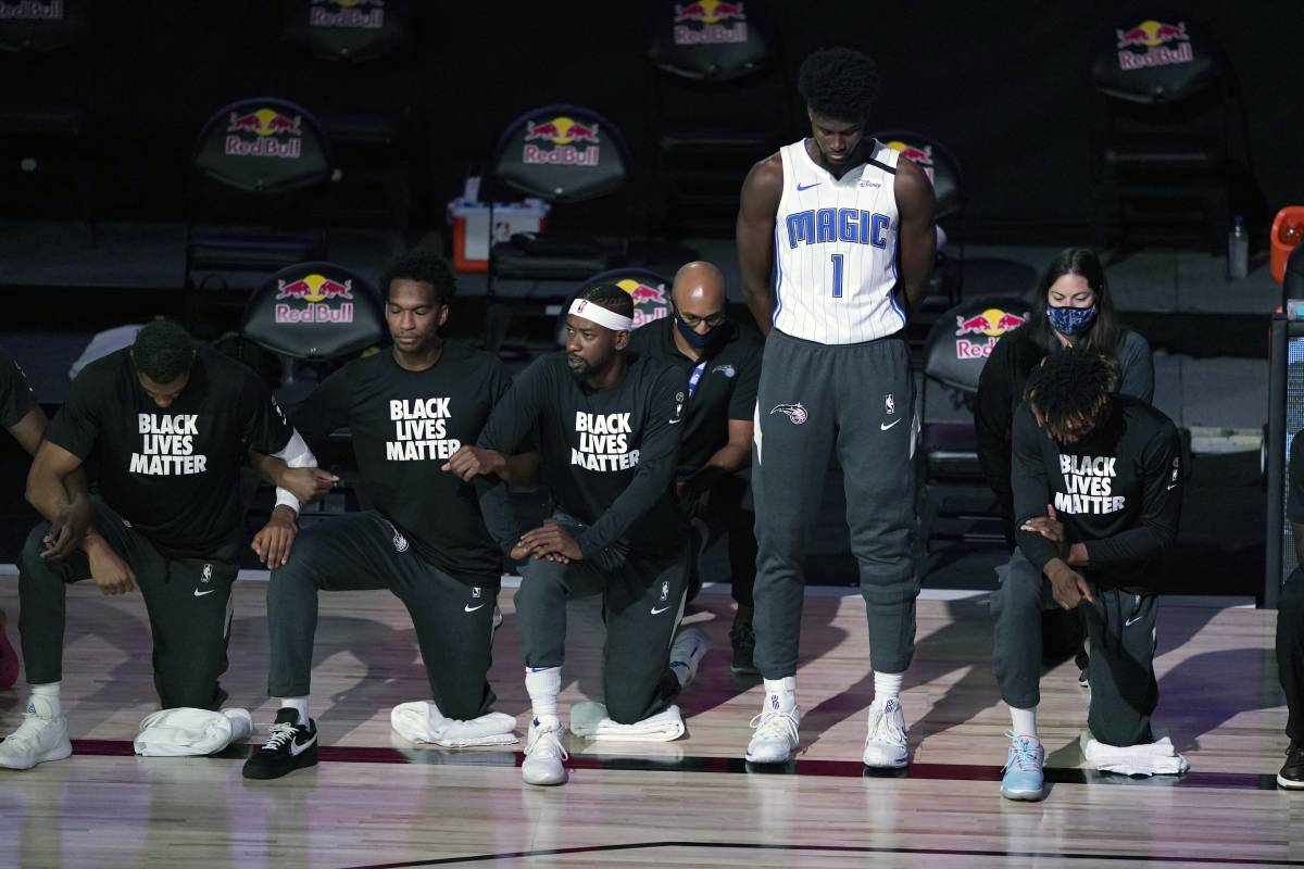 Orlando Magic star Jonathan Isaac didn't kneel for the national anthem or wear a 'Black Lives Matter' shirt on July 31. | Ashley Landis - Pool/Getty Images