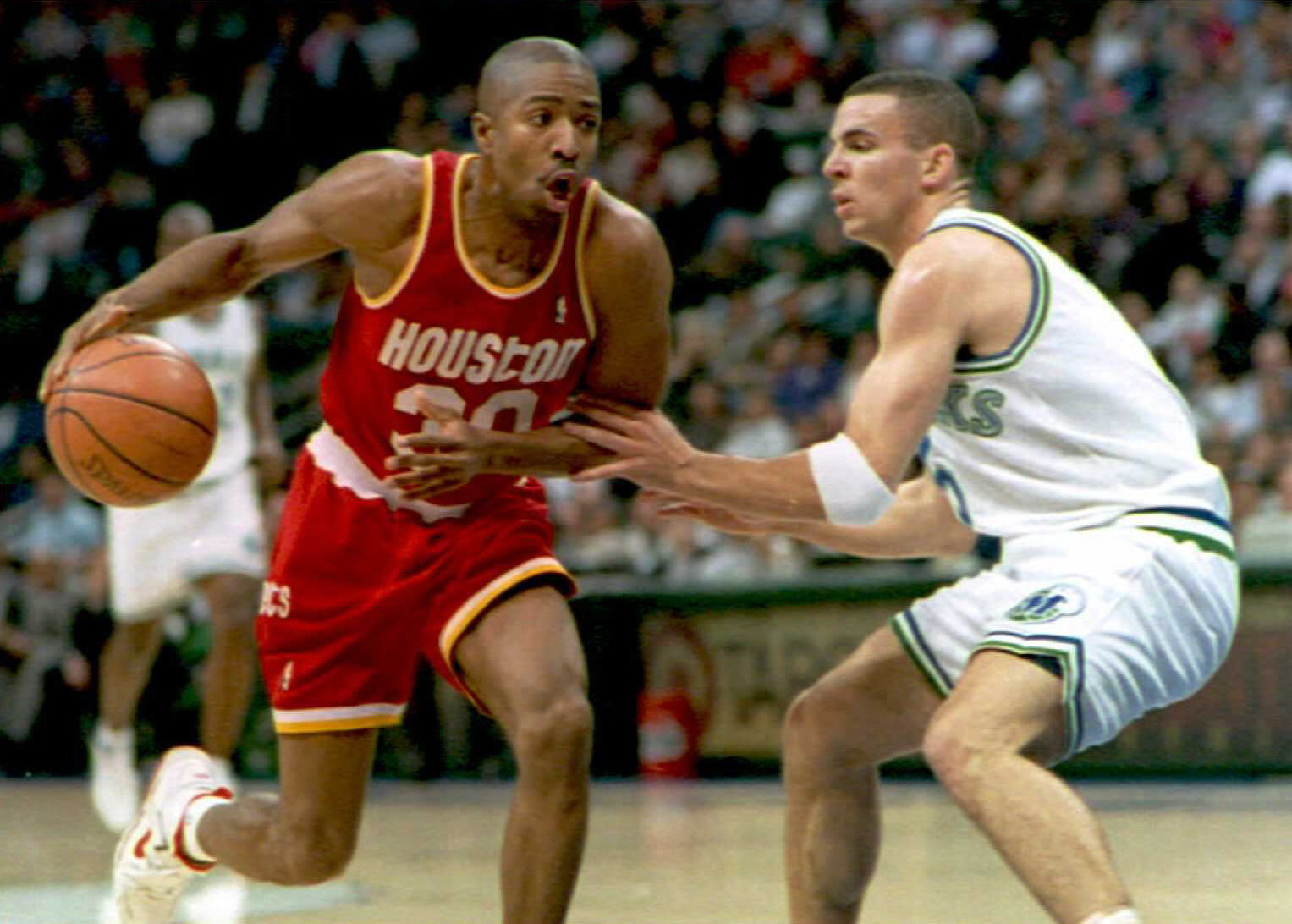 Kenny Smith dribbles the ball for the Houston Rockets