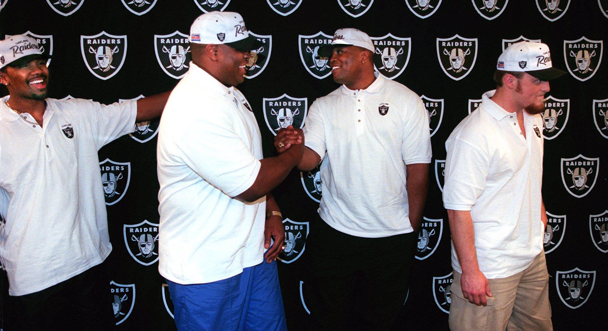 Leon Bender (second from right) died only weeks after he signed his first NFL contract with the Oakland Raiders in 1998.