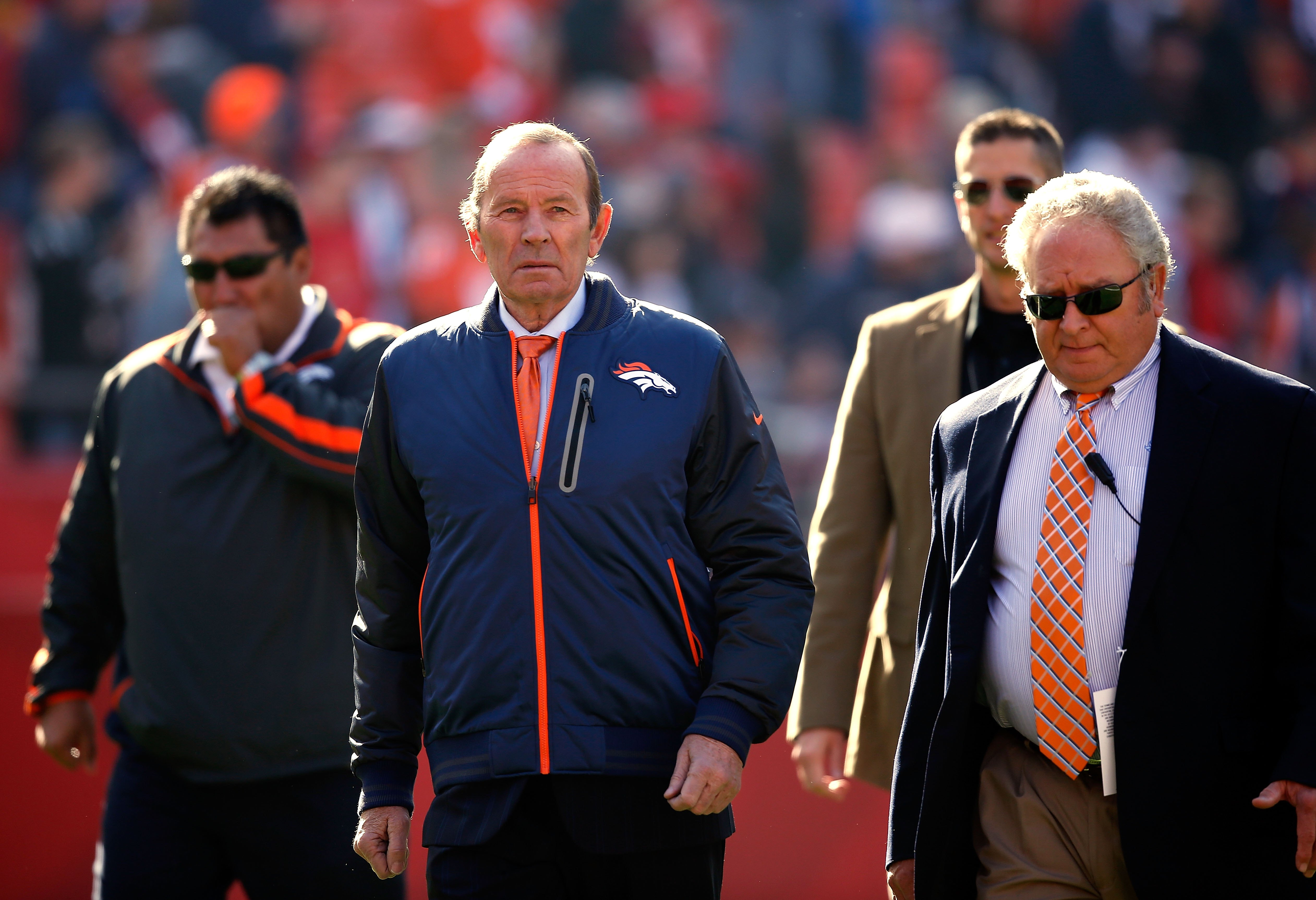 PatBowlen of the Denver Broncos watches player warm-ups