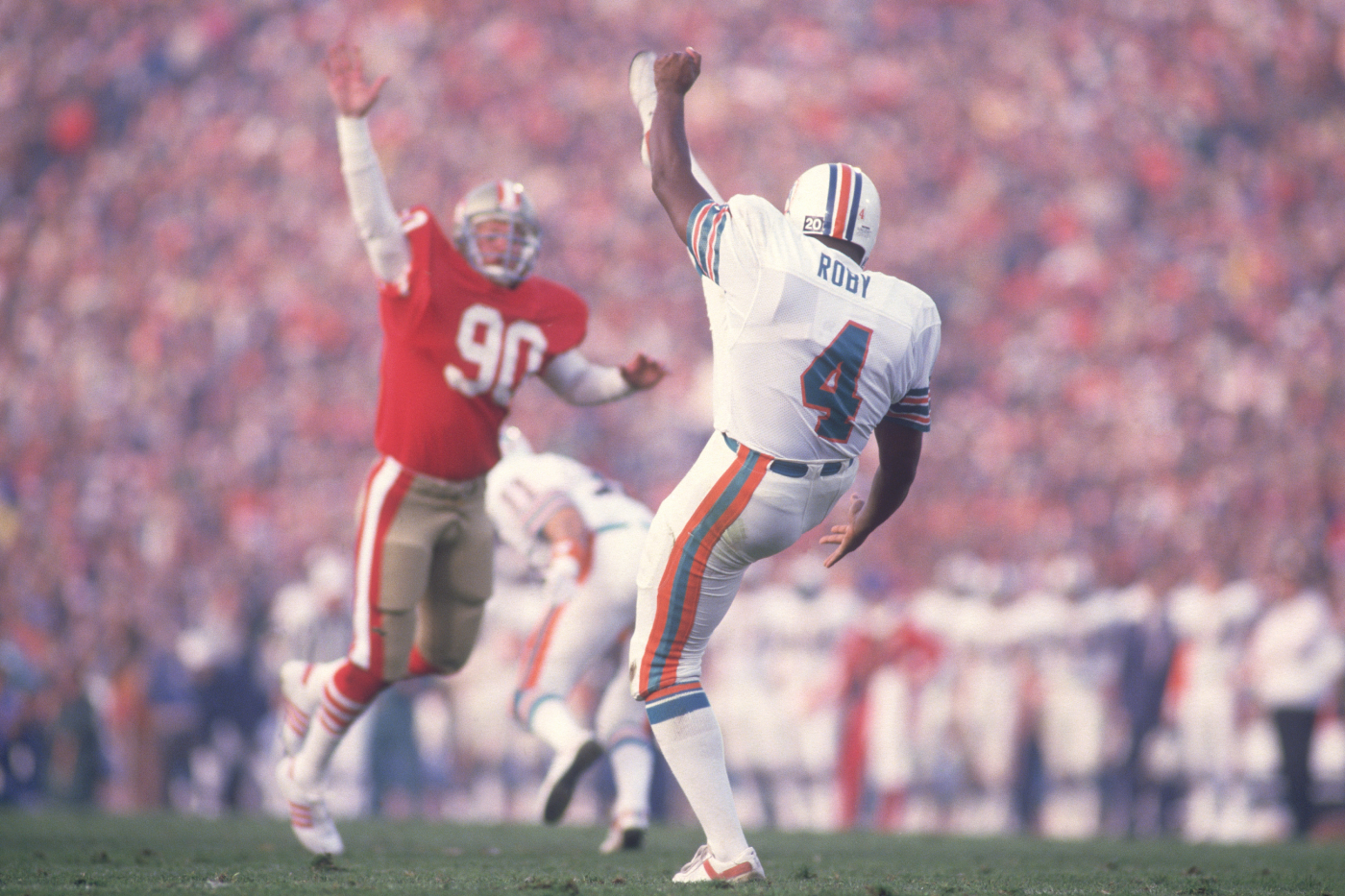 Reggie Roby was a very successful punter for the Miami Dolphins and broke down color barriers in the NFL. He, however, sadly died too young.