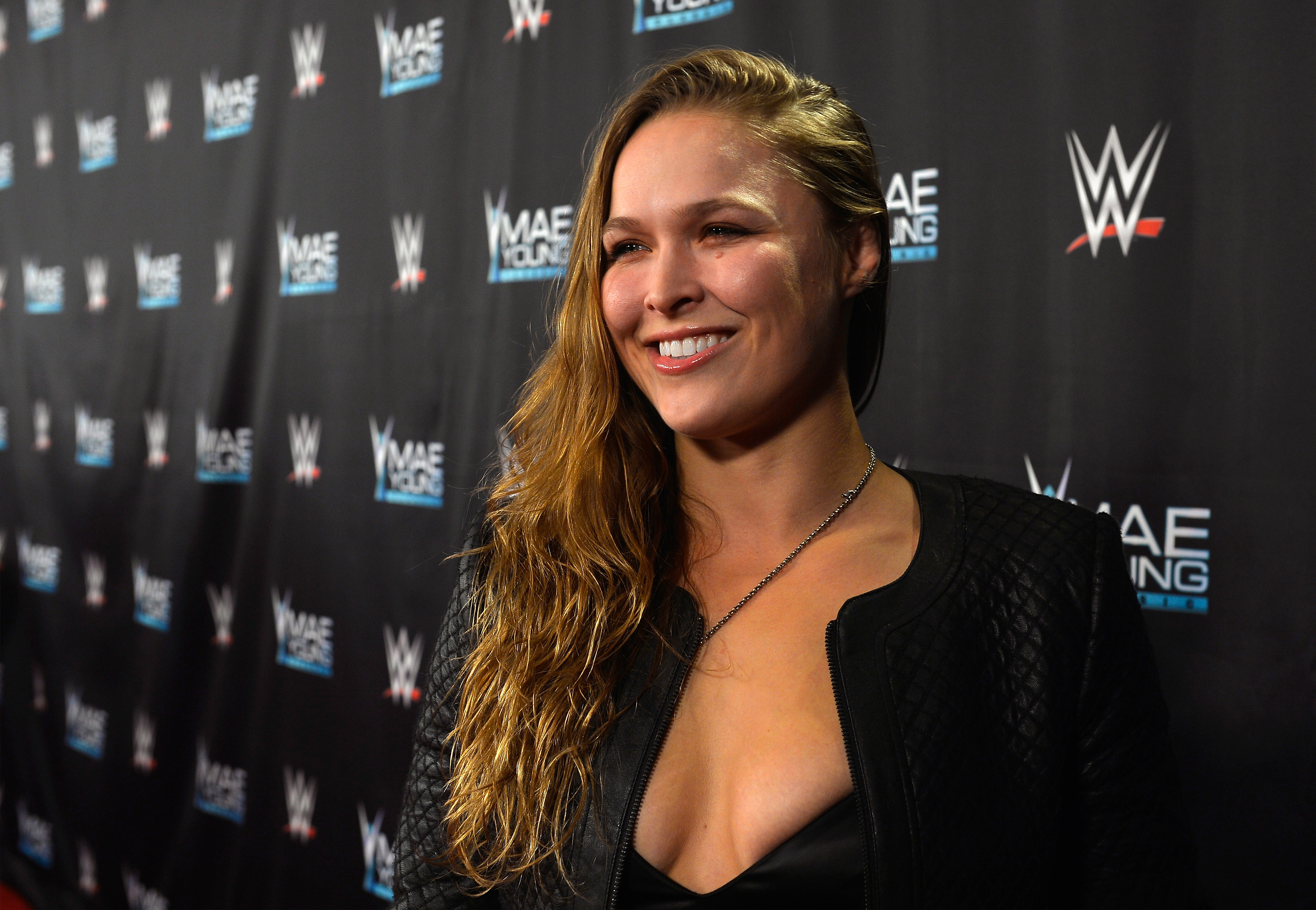 Ronda Rousey poses for a photo at a WWE event