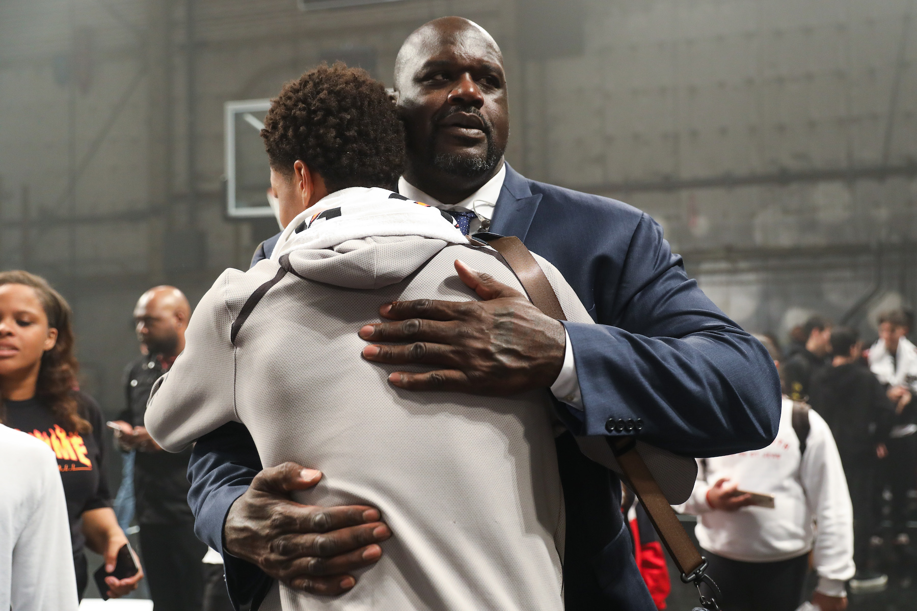 Shaquille O'Neal (R) hugs his son Shareef O'Neal