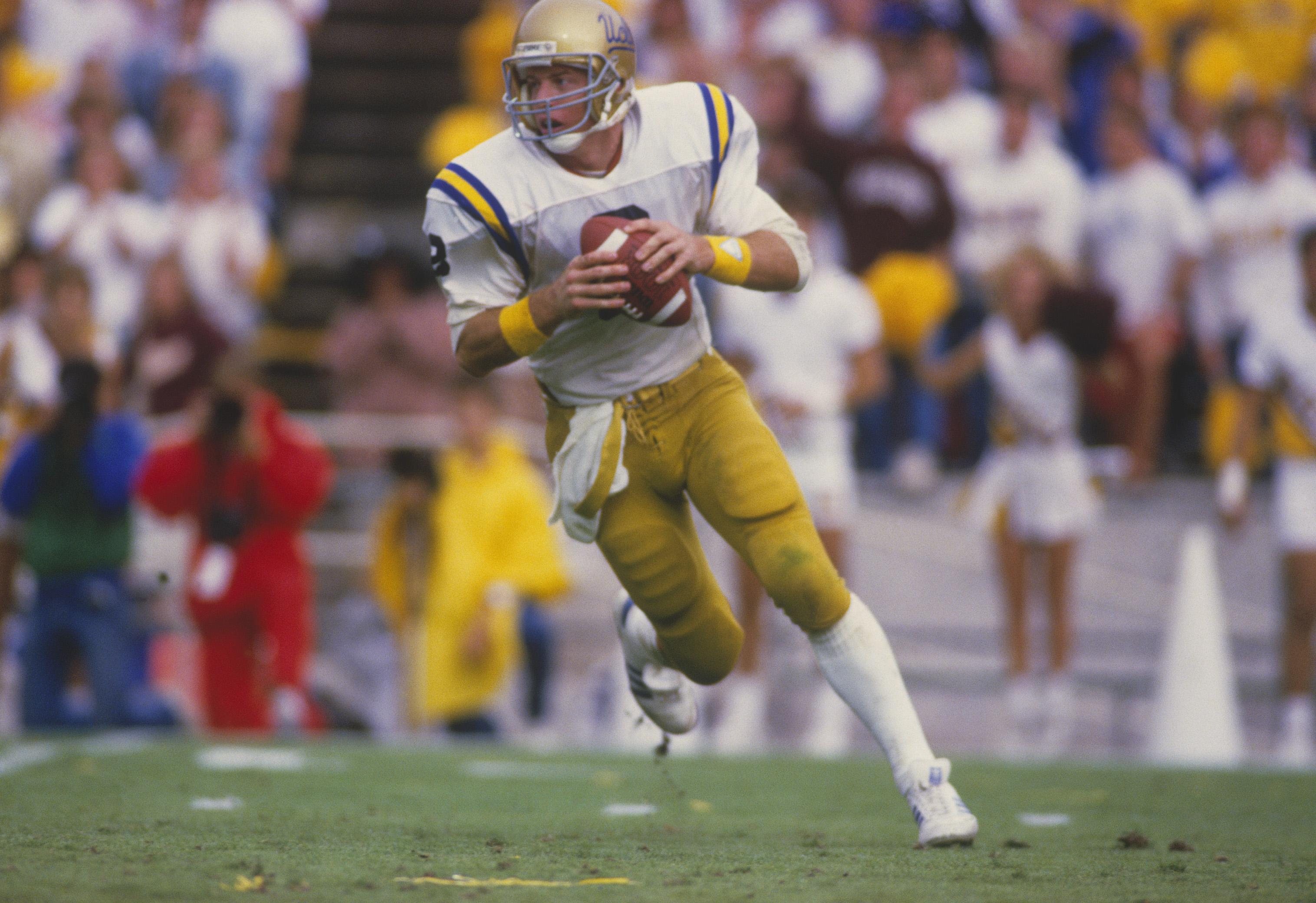 UCLA quarterback Troy Aikman runs with the ball