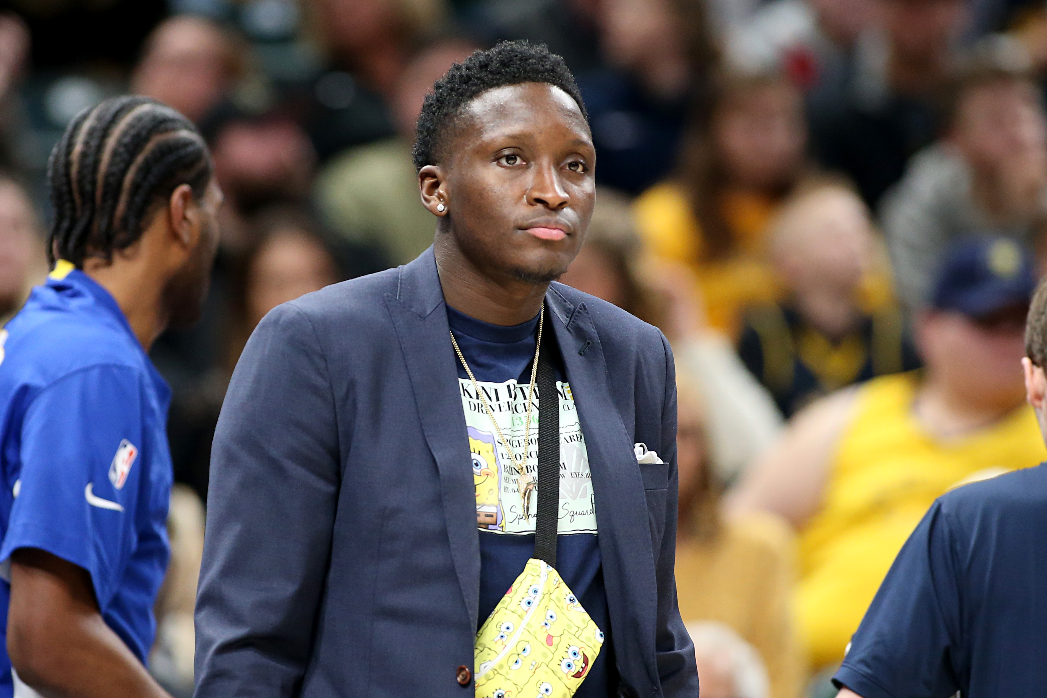 Victor Oladipo watching a Pacers game from the sidelines